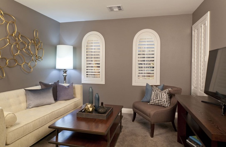 San Jose family room with arch plantation shutters.