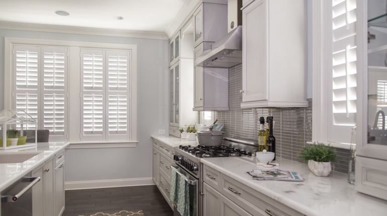 Polywood shutters in San Jose kitchen with marble counter.