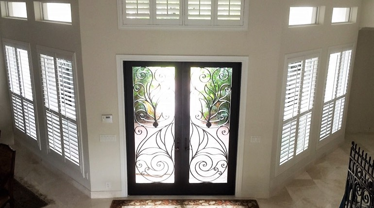 San Jose foyer with glass doors and indoor shutters