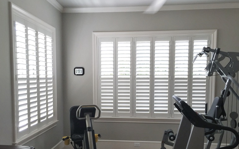 San Jose fitness room with shuttered windows.