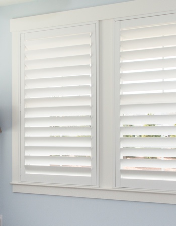 White plantation shutters with hidden tilt rods in San Jose