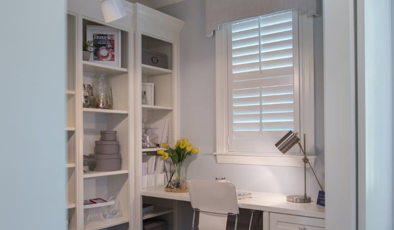 Home office with polywood shutters.