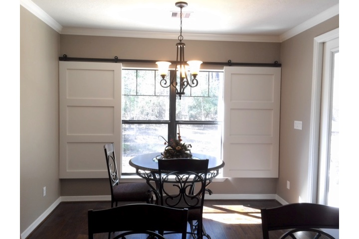 San Jose dining room with classic barn door shutters.