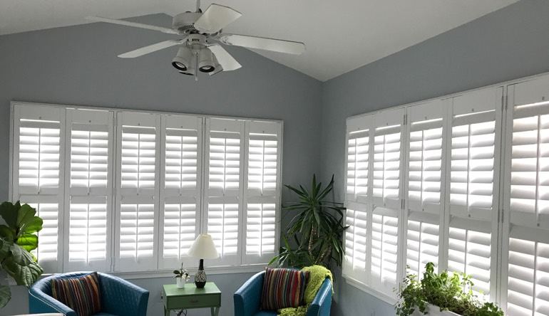 San Jose sunroom with fan and shutters