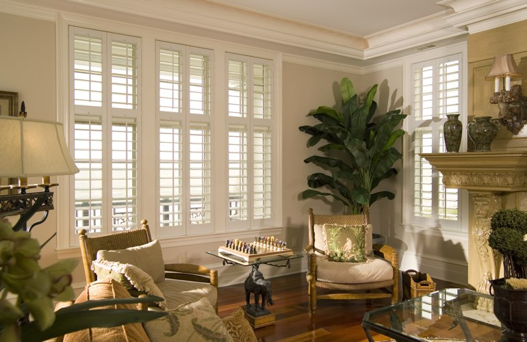 Living Room in San Jose with polywood plantation shutters.