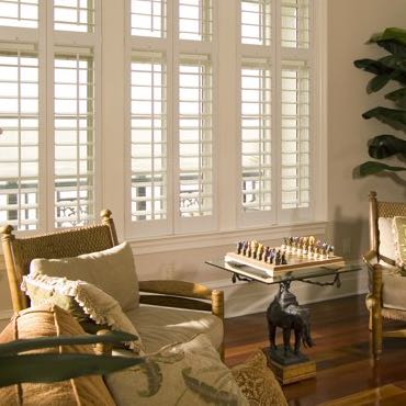 San Jose living room polywood shutters.