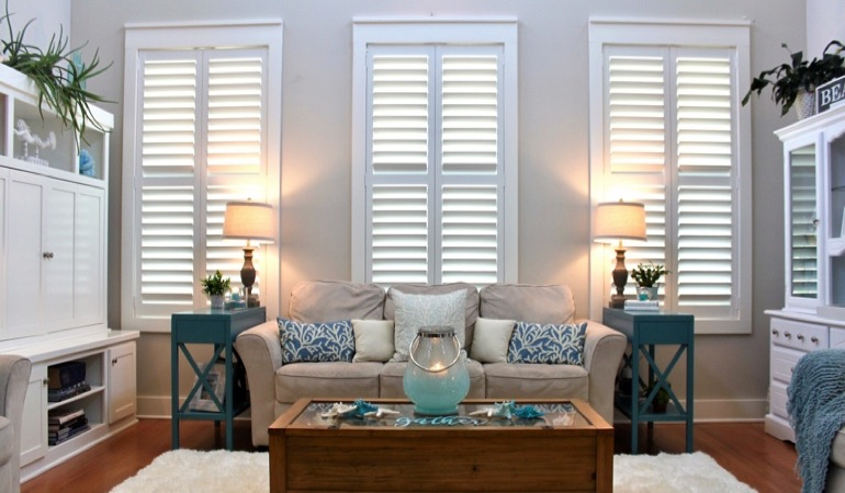 San Jose designer sunroom with chic shutters