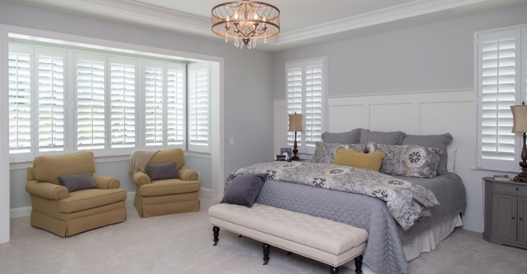 Plantation shutters in San Jose bedroom.