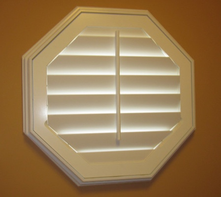 San Jose octagon window with white shutter