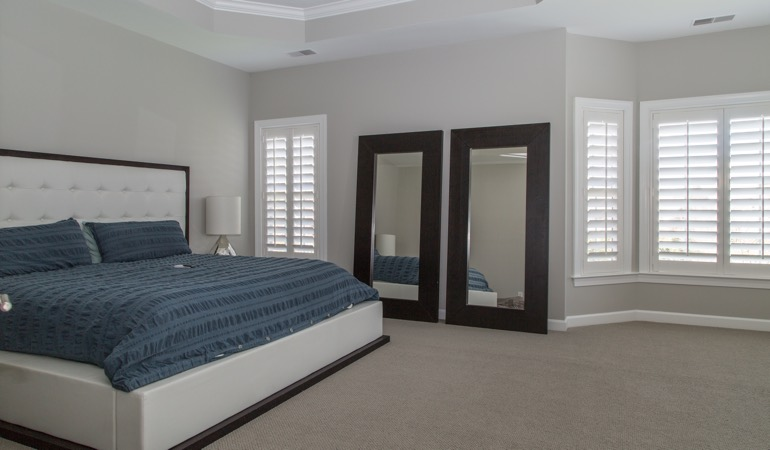 White shutters in a minimalist bedroom in San Jose.