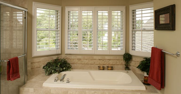 Plantation shutters in San Jose bathroom.