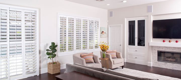 San Jose living room in white with plantation shutters.