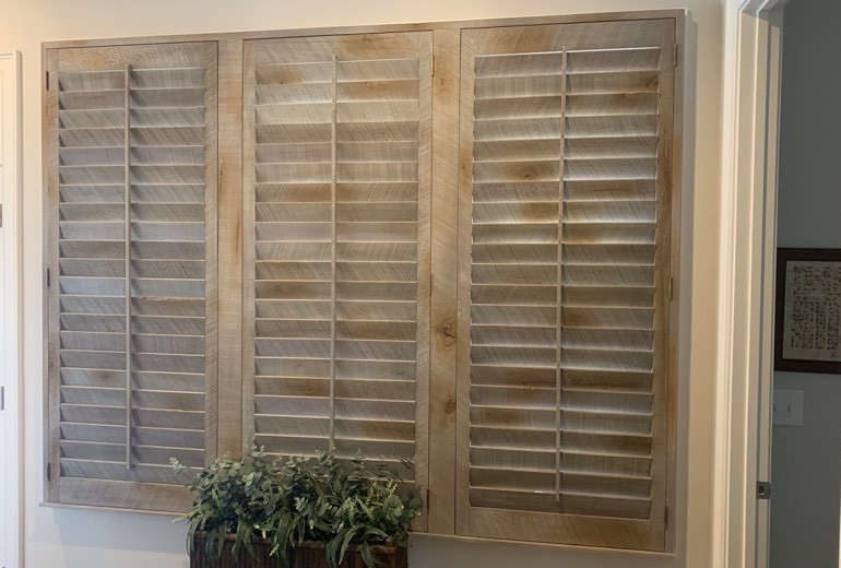 Closed reclaimed wood shutters in San Jose