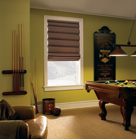 Roman shades in San Jose game room with green walls.