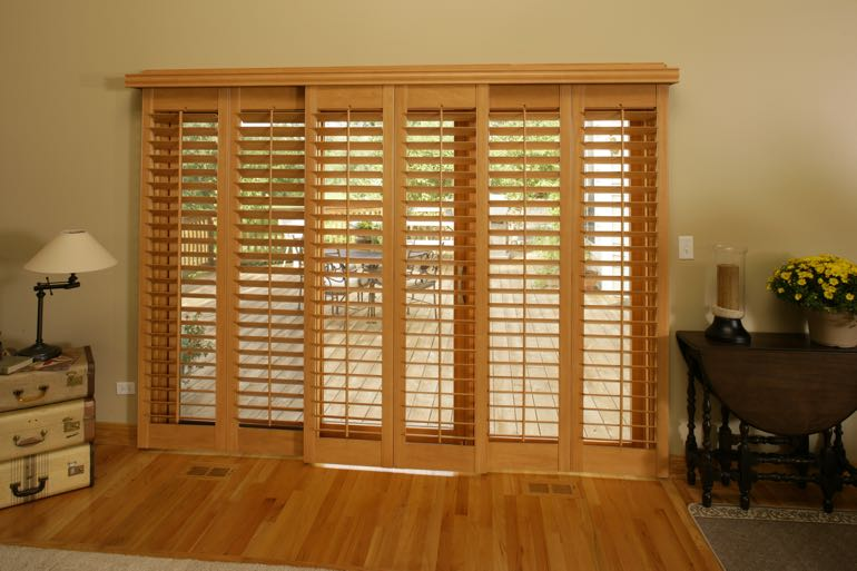 Faux wood shutters on sliding door leading to back porch.