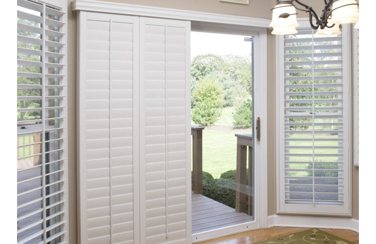 Sliding door with shutters leading out to patio