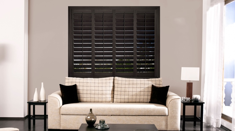 San Jose sunroom with black shutters.