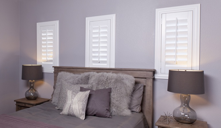 Studio plantation shutters in San Jose bedroom windows.