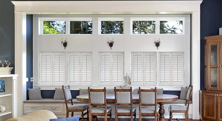 Closed classic plantation shutters in San Jose dining room.