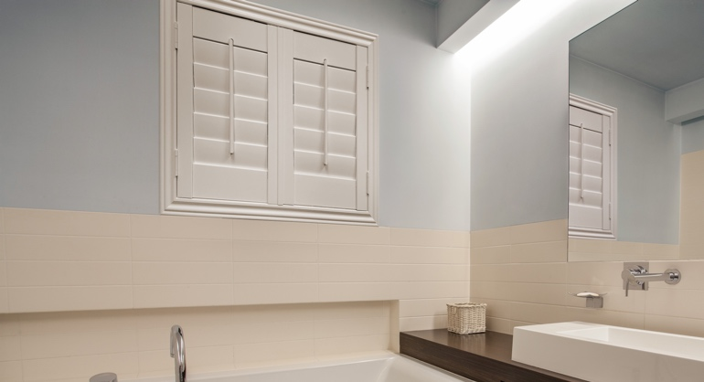 White waterproof shutters in San Jose bathroom.