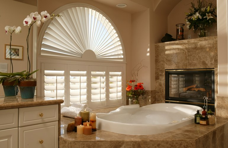 Semicircle shutters in a San Jose bathroom.