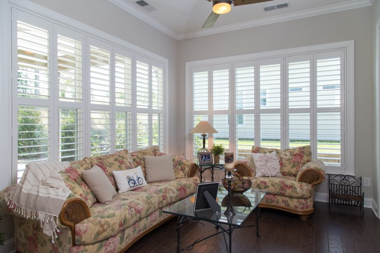 Traditional sunroom with interior shutters in San Jose.