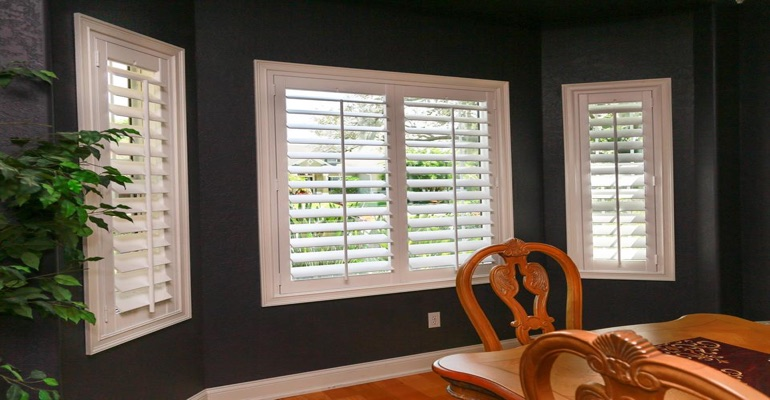 White Polywood Shutters In Dining Room With Dark Paint