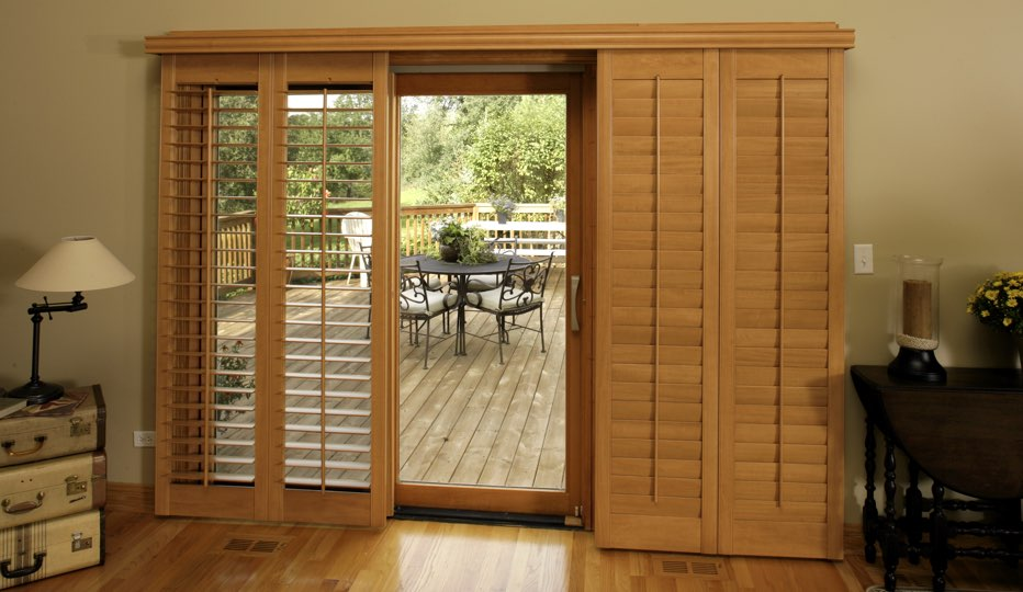 Bypass wood patio door shutters in San Jose living room
