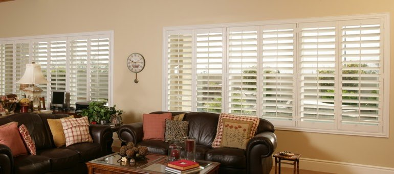 Wide window with white shutters in San Jose living room